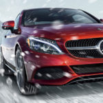 Red Mercedes-Benz C300 with 4MATIC AWD in Snow