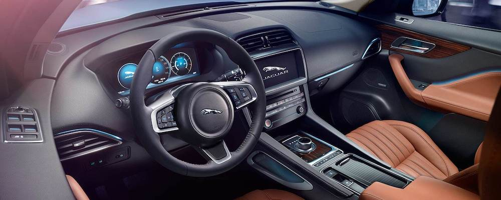 2019 Jaguar F‑PACE Portfolio Driver Side Interior with vintage tan leather