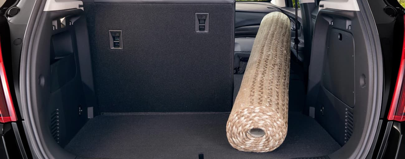 The cargo space of the 2019 Buick Encore is shown with a rug after leaving a store in Atlanta, GA. Check out cargo space when comparing the 2019 Buick Encore vs 2019 Hyundai Kona.