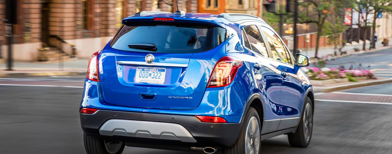 A blue 2019 Buick Encore is driving down an Atlanta, GA street.