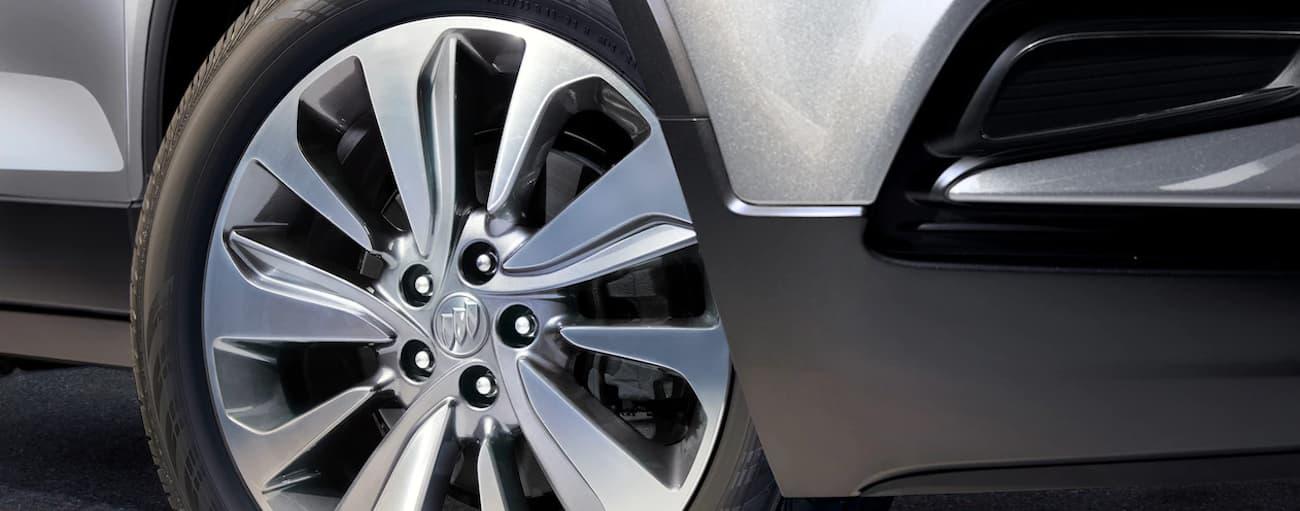 The rim of a 2019 Buick Encore is shown. Check out wheel size when comparing the 2019 Buick Encore vs 2019 Hyundai Kona in Atlanta, GA.