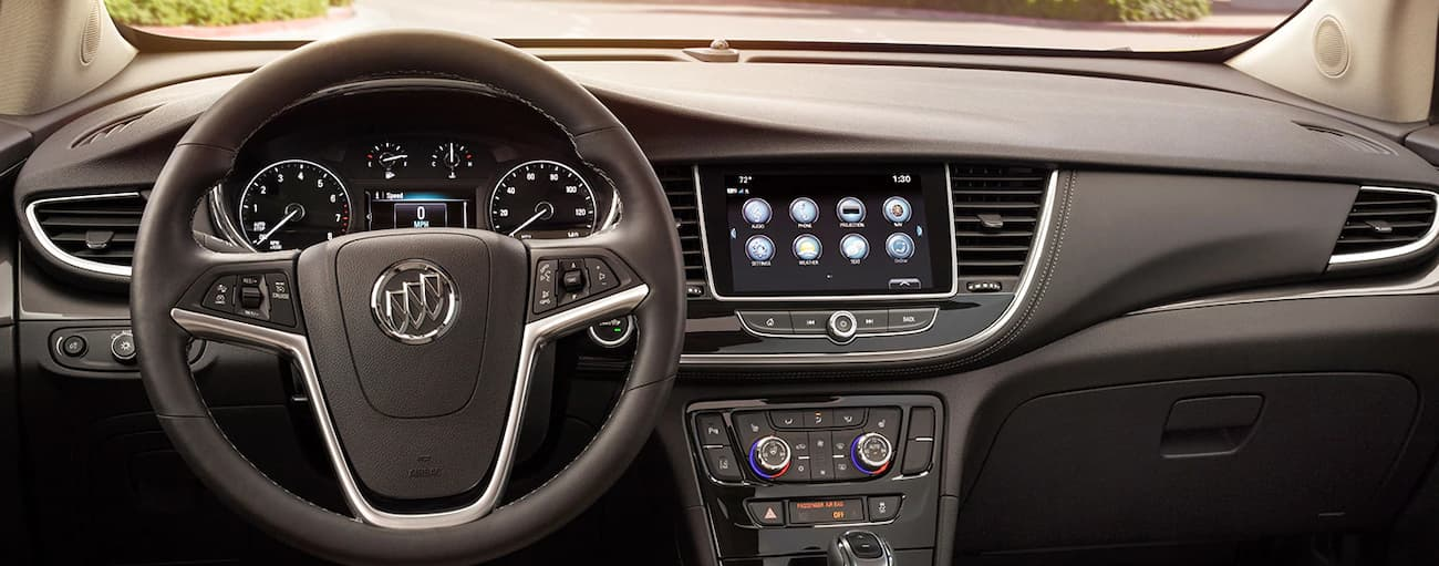 The black interior and screen of the 2019 Buick Encore is shown while the car is parked in Atlanta, GA.