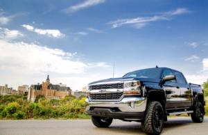 Chevrolet Silverado in front of downtown Saskatoon