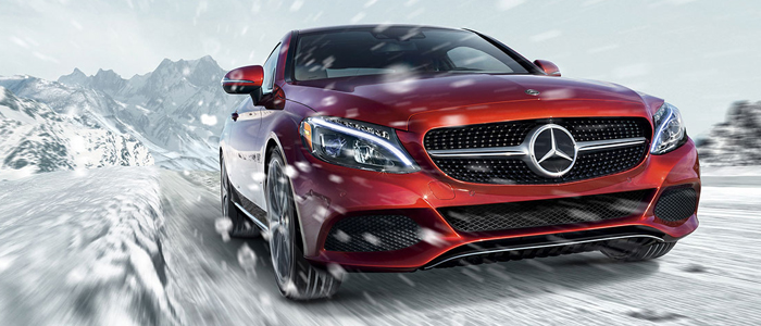 Red C 300 driving through snow