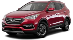 A red 2017 used Hyundai Santa Fe Sport is facing left.