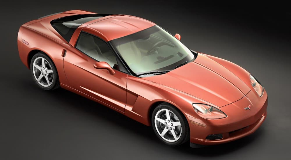 A red 2005 used Chevy Corvette is angled right on a black background.