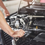 Close Up of Man's Hands Performing Car Maintenance